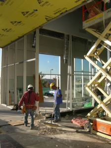 Existing storefront is removed. Curtainwall continues.