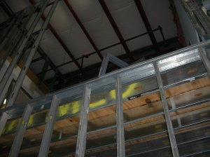 Mechanical mezzanine framed using light gauge metal framing.