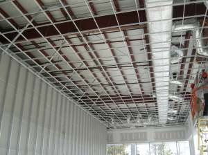 Ceiling grid in front portion of Showroom expansion is complete