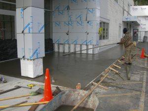Concrete sidewalk is poured.