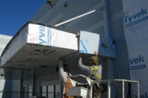 ACM panel installation continues at canopies.
