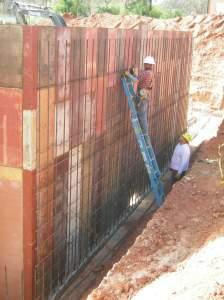 Retaining wall rebar work underway
