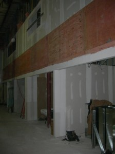 Sheetrock installation for the current phase is nearly complete.