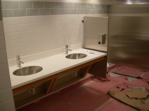 Restroom fixtures and accessories installed