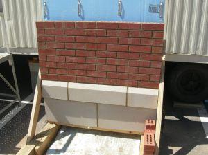 Sample panel with brick and cast stone.
