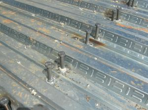 Sheer studs welded in place as part of composite slab.