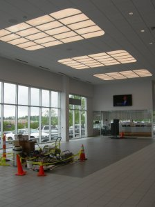 Ceramic tile work in expanded Showroom nears completion.