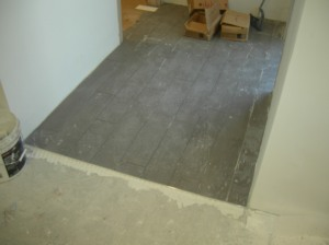 Floor tile in Owner's office.