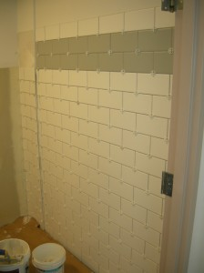 Wall tile installation in a restroom.