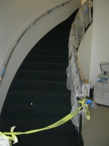 Carpeting installed on the curved stairs.