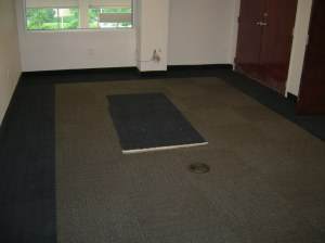 Carpet tile in the Owner's office, with a carpet border and carpet base.