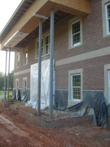 Front masonry complete except entry vestibule