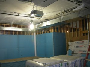 Impact-resistant sheetrock goes up.