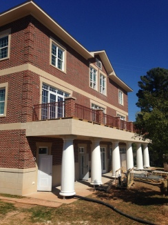 Column wraps and decorative rail installed on rear of house