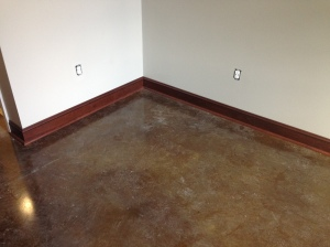 Stained concrete with wood base.