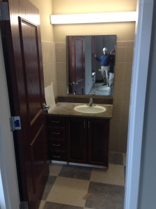 Raised panel doors, bathroom vanities installed