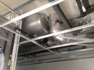 Exhaust ducts from the kitchen hood and dishwasher hood installed and turned up towards roof.