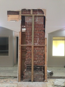 Existing brick hidden under studs and sheetrock will be exposed permanently.