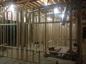 Framing complete, sheetrock installation underway.