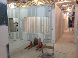 Gypsum board installation nears completion.