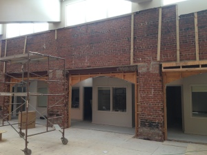 Existing 90-year old brick walls need work, but will be a major feature in the building.