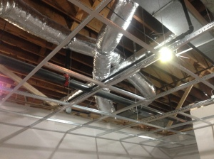 Ceiling grid installed on 1st floor.