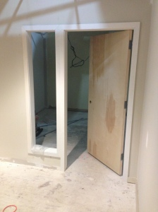 Trim work and door installation underway.